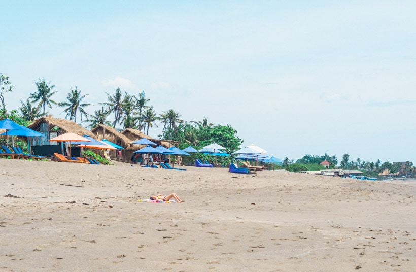 Girl tanning at Batu Bolong Beach Canggu Bali