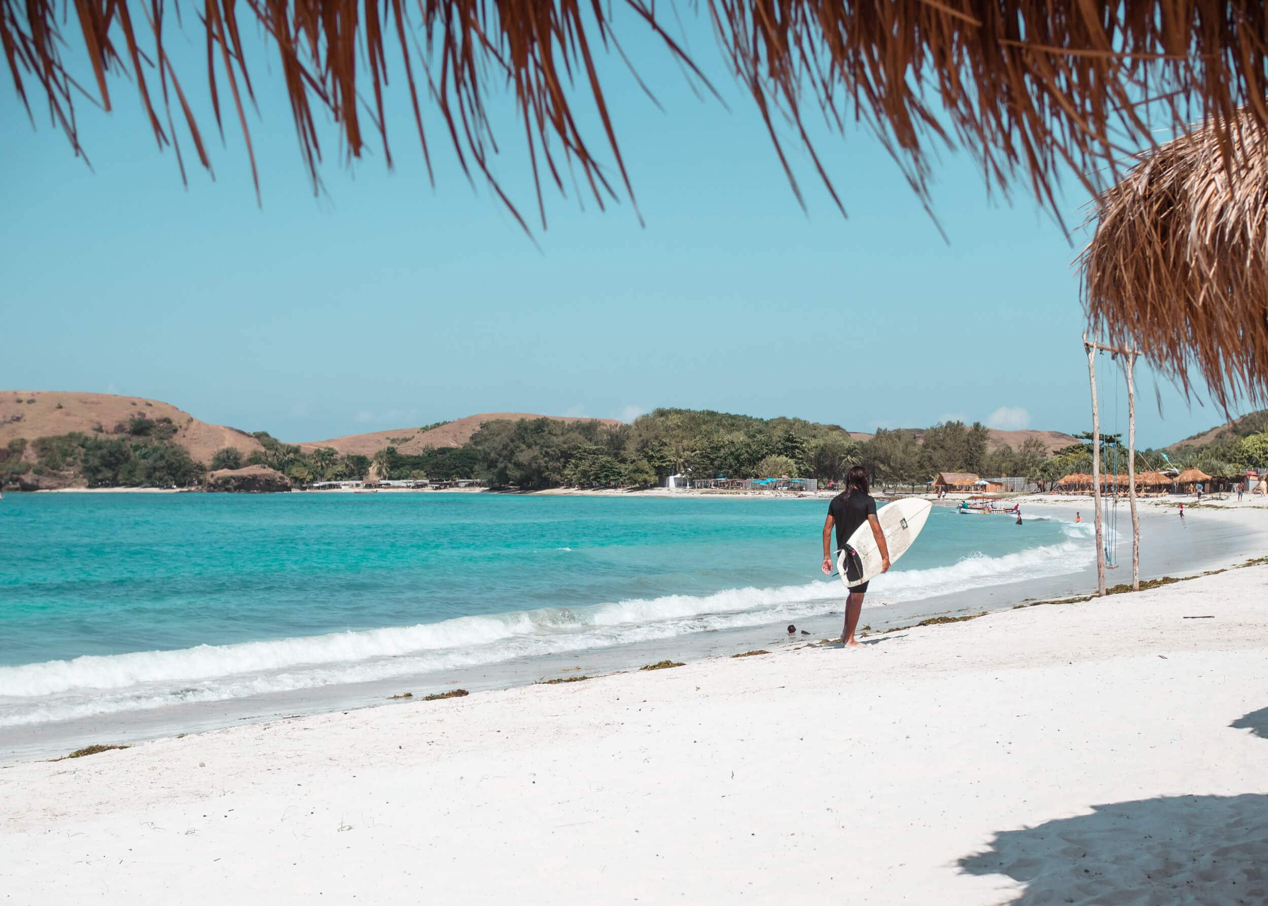 Surfer on Tanjung Aan, the best beach in Lombok