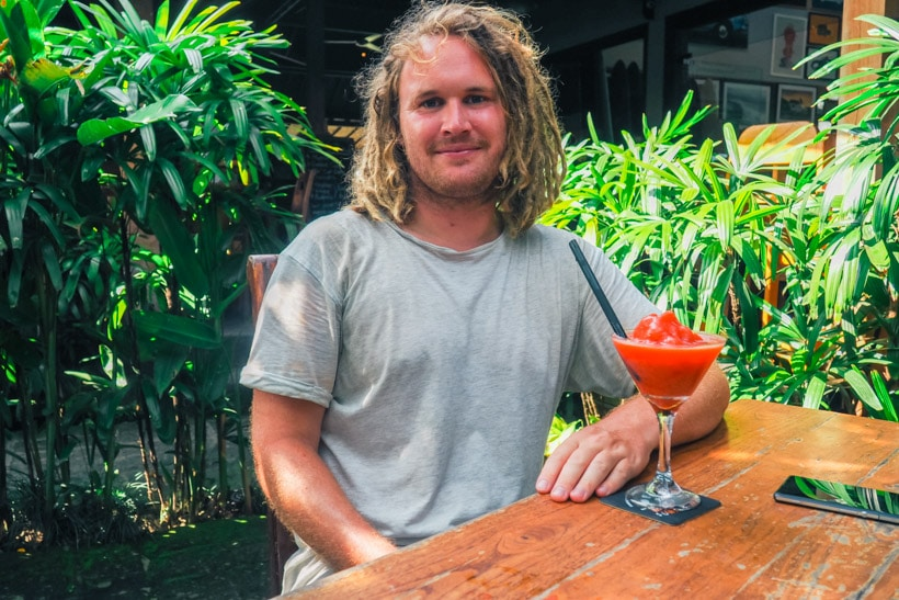 Surfer having lunch at Deus ex Machina Canggu