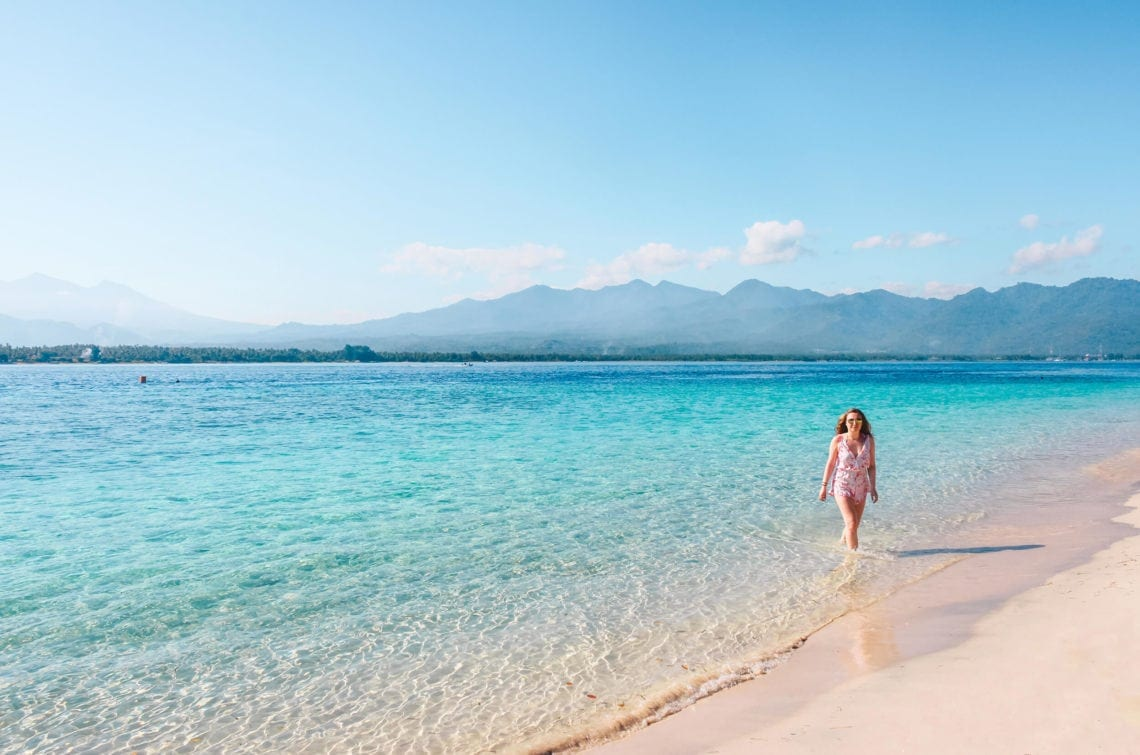 Walking in the turquoise water of Gili Air - One of the three gorgeous Gili Islands outside Lombok, Indonesia