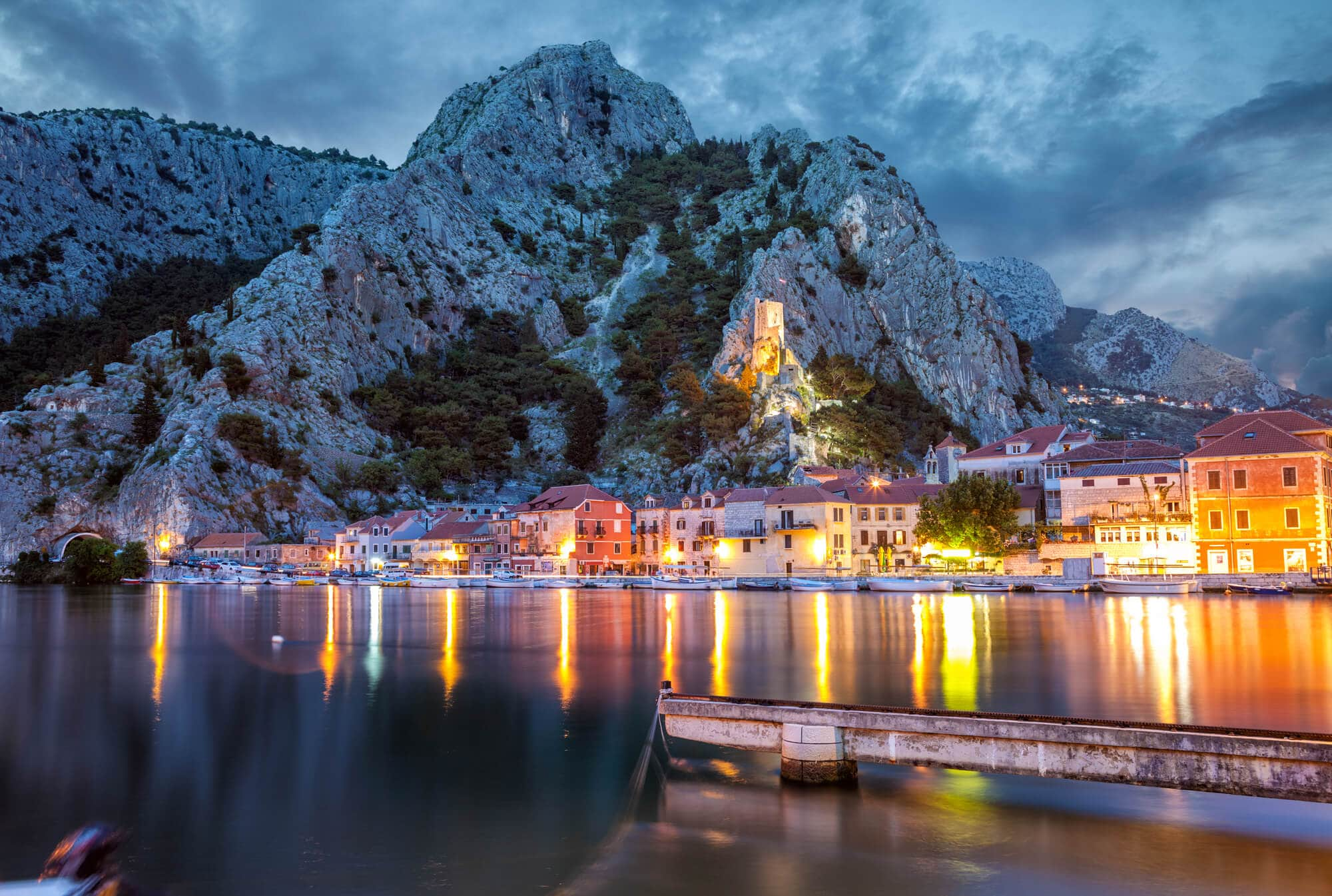 Lights reflecting in the ocean in Omis, Croatia