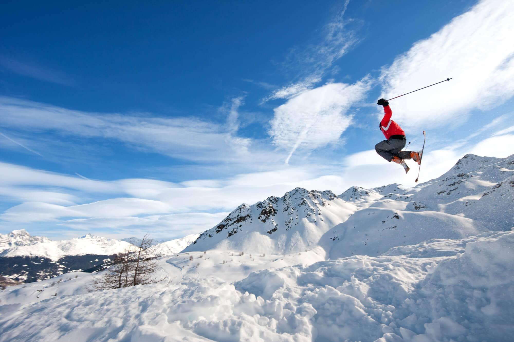 Norwegian skier jumping on snow-clad mountain #norway