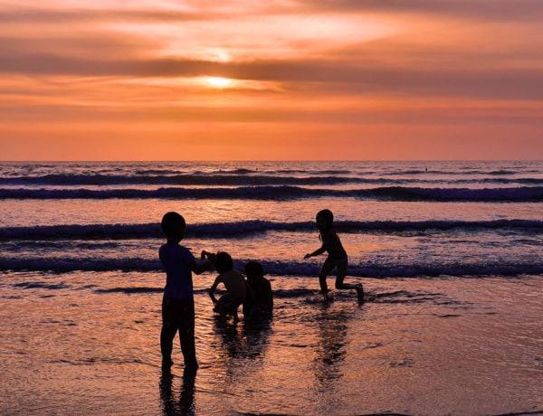 Children playing on Kuta Beach - The dark side of Bali